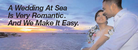 Young couple on the deck of a cruiseship at sunset. A wedding at sea is vry romantic. And we make it Easy.