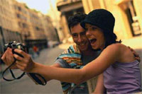 Honeymoon Excursion - young couple taking selfies
